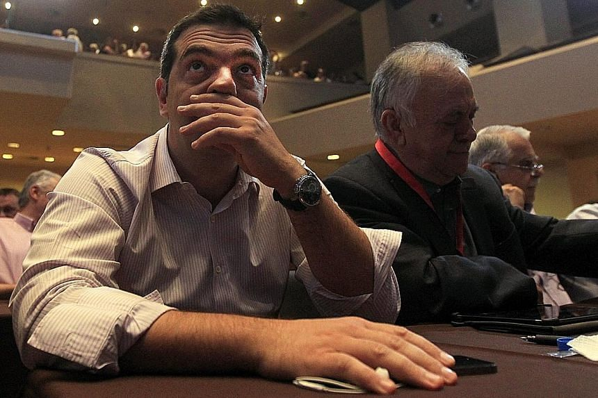 Mr Alexis Tsipras (far left) attending a Syriza party central committee meeting in Athens yesterday in an attempt to settle differences among party members.