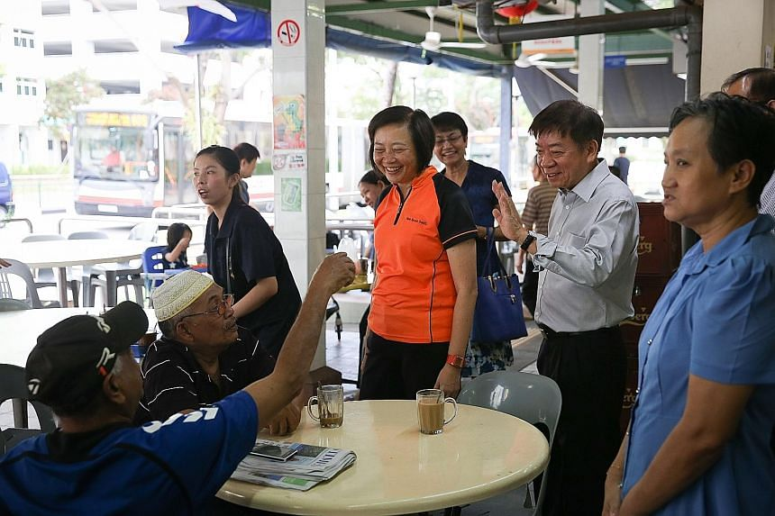 Sembawang GRC MP Khaw Boon Wan (in light shirt) with Nee Soon GRC MP Lee Bee Wah at a coffee shop in Yishun. Right, from top: The other Sembawang GRC members, Ms Ellen Lee and Mr Vikram Nair, will be joined by Dr Lim Wee Kiak and possibly Mr Amrin Am