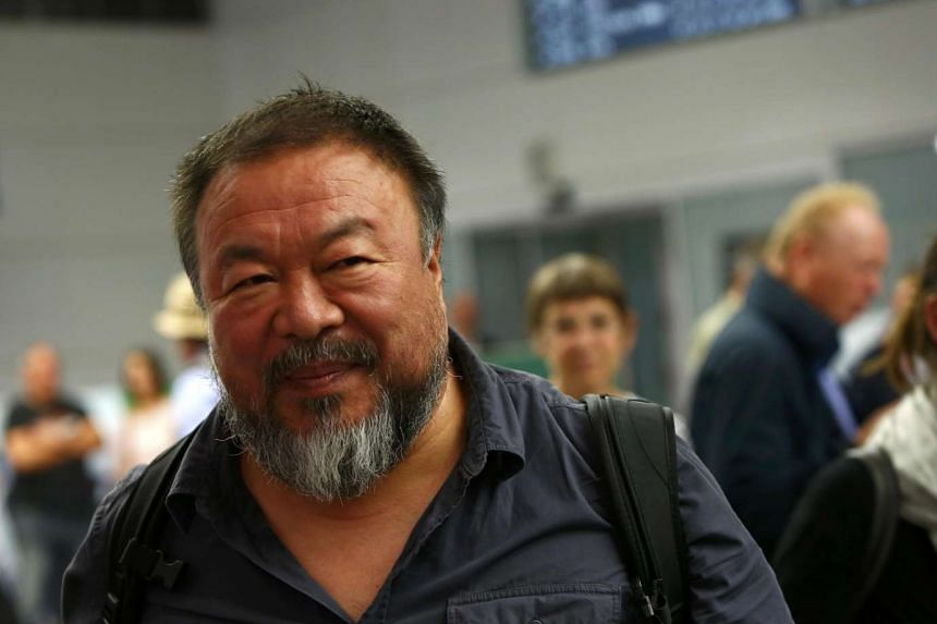 Dissident Chinese artist Ai Weiwei arrives at the airport in Munich, Germany July 30, 2015.
