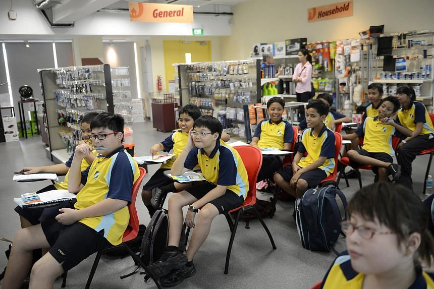 Students at Crest Secondary School attending lessons inside a classroom modelled after a Home-Fix DIY store for their retail services module.