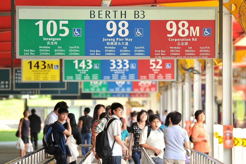 Commuters at Jurong East bus interchange. Tower Transit will operate 26 bus services from the Jurong East, Bukit Batok and Clementi bus interchanges.