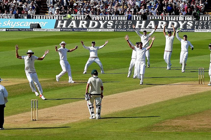 England's Steven Finn (fifth from right) and teamates unsuccesfully appeal for the wicket of Australia's Mitchell Marsh on the second day of the third Ashes cricket test match between England and Australia on July 30, 2015.