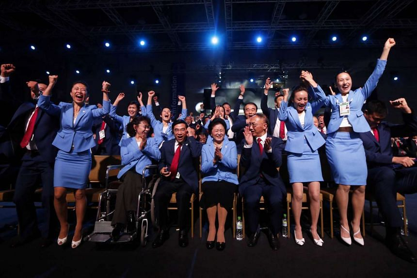 Members of the delegation from Beijing 2022 Winter Olympics candidate city reacts after the city was elected to host the 2022 Olympic Winter Games.
