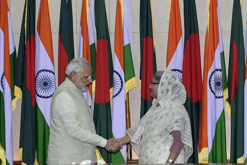 Indian Prime Minister Narendra Modi (left) shakes hand with Bangladeshi Prime Minister Sheikh Hasina Wajid (right) on June 6, 2015.