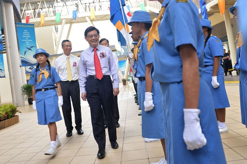 Education Minister Heng Swee Keat inspects the Girl Guides at Crest Secondary's official opening.