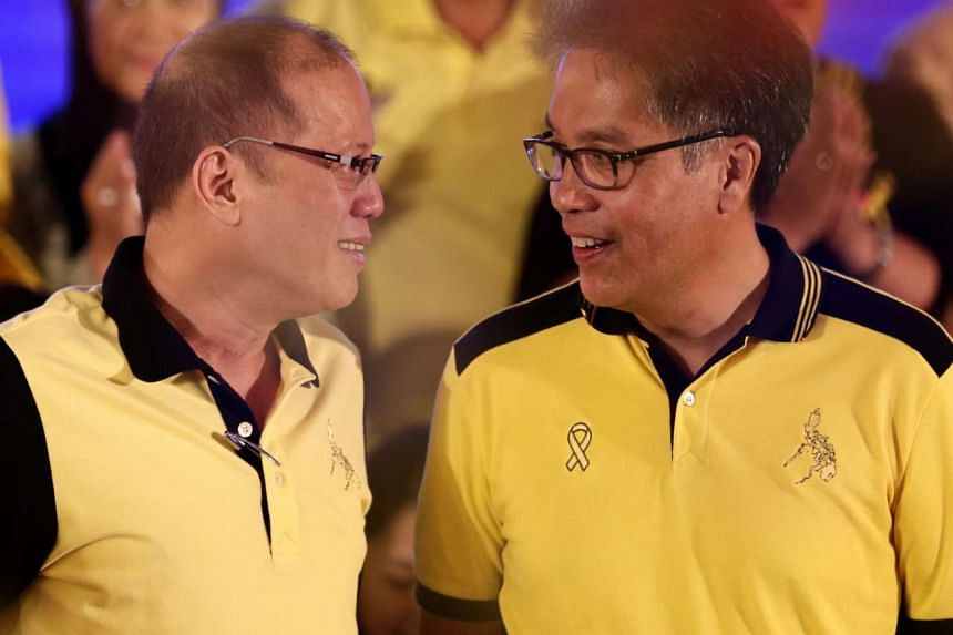 President Benigno Aquino III (left) with his Interior Secretary Manuel 'Mar' Roxas III (right) during a political party gathering on July 31, 2015.