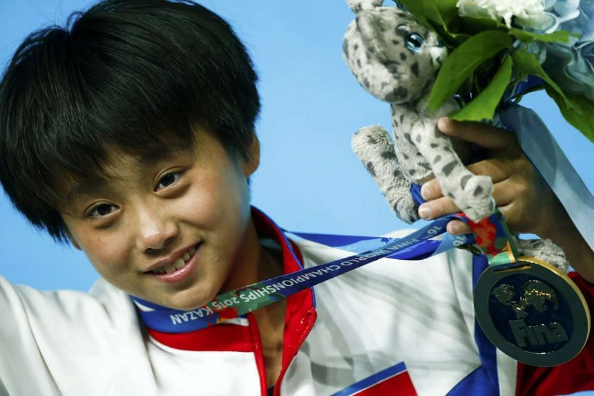 : Kim Kuk-hyang of North Korea poses with her gold medal.