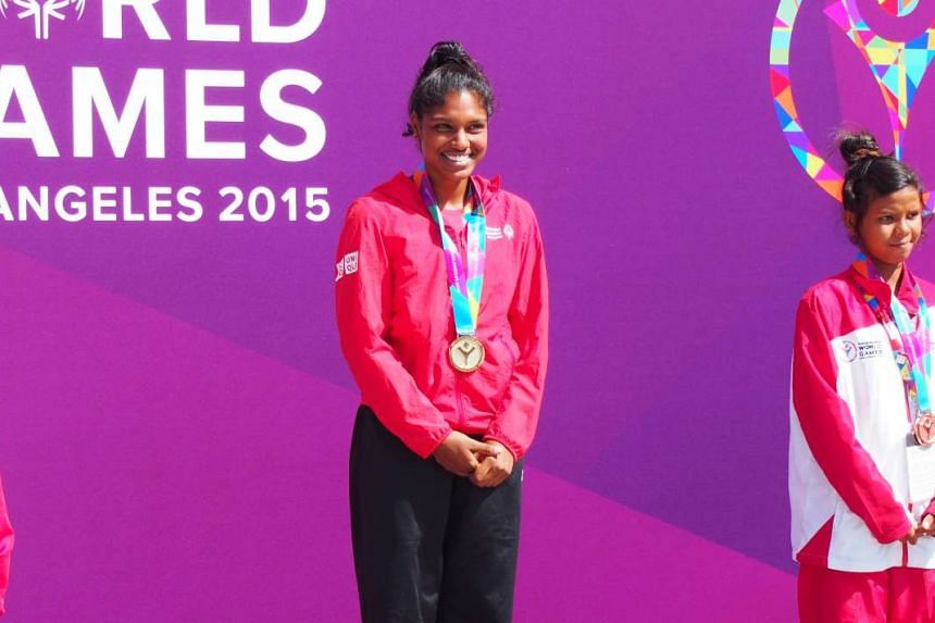 Singapore athlete Michelle Yogeswari Krishnamoorthy with her Gold medal at the Special Olympics World Summer Games.