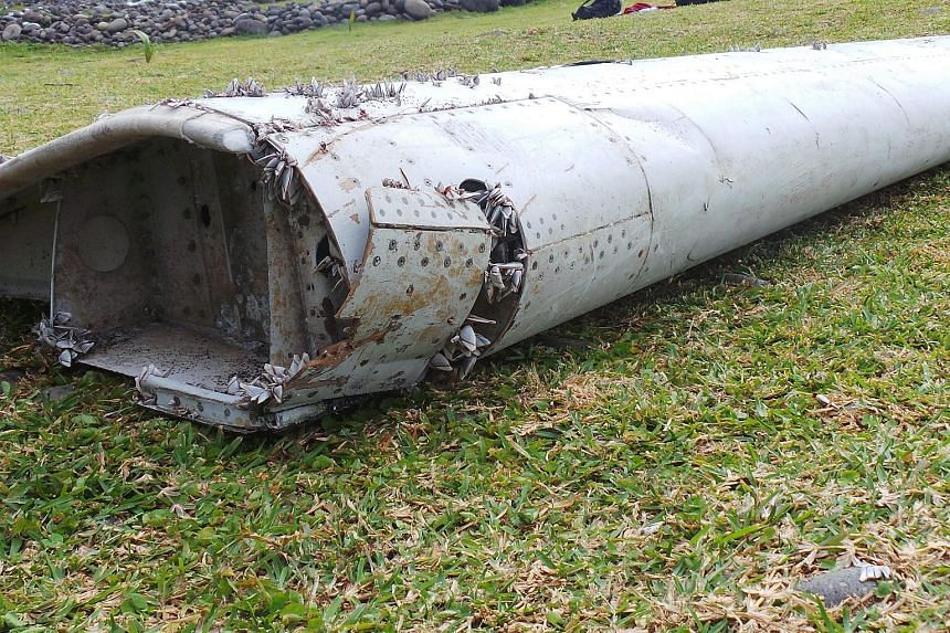 A piece of debris from an unidentified aircraft which had washed ashore in Saint-Andre de la Reunion, eastern La Reunion island, France, on July 30, 2015.