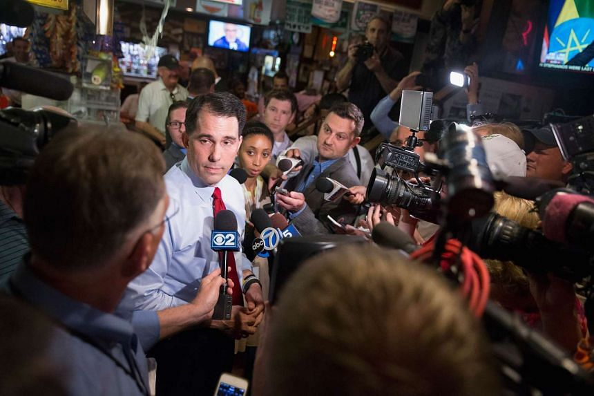 Republican presidential hopeful Scott Walker is interviewed during a campaign stop at the famed Billy Goat Tavern on July 27, 2015 in Chicago, Illinois.