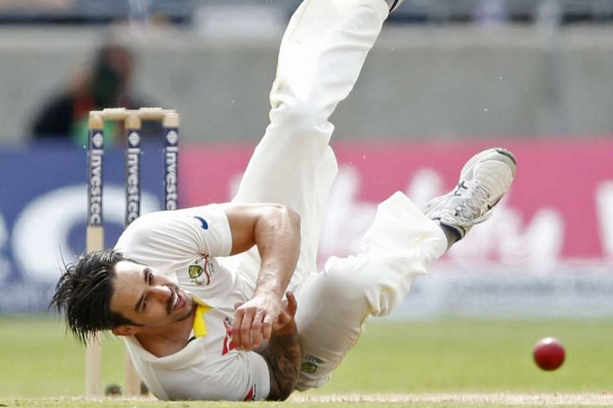 Mitchell Johnson takes a tumble on his way to 2-66. The tourists' spearhead became only the fifth Australian bowler to take 300 Test wickets, even as England established a 145-run first-innings lead.