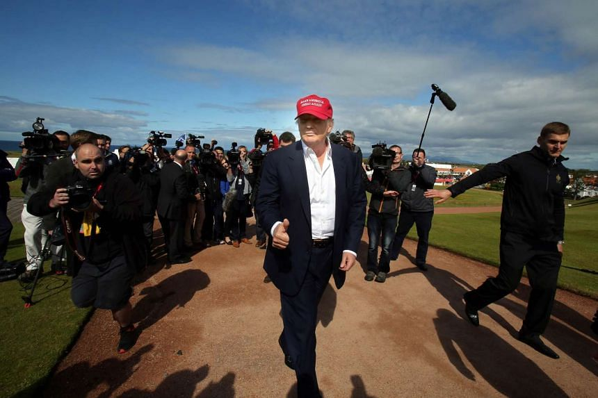 US billionaire Donald Trump (centre) arrives at the Women's British Open Golf Championships in Turnberry, Scotland.