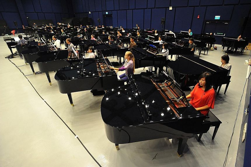 Pianists at a rehearsal last month for the Sing50 concert. Insurance group Zurich has pledged to donate $5 for every person who attends the show. Mr Jonathan Rake, chief executive of Zurich's general insurance business in Singapore, encouraged those