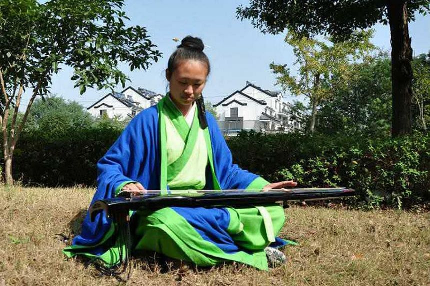 Ms Hao Liya, 22, has an engineering degree but has been ordained as a Taoist priest.