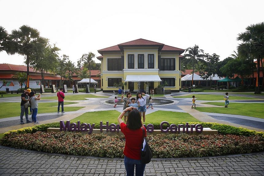 Tourists taking pictures at the Istana Kampong Gelam, the historic residence of Malay royals that is now home to the Malay Heritage Centre. It will be gazetted as a national monument on Aug 6.