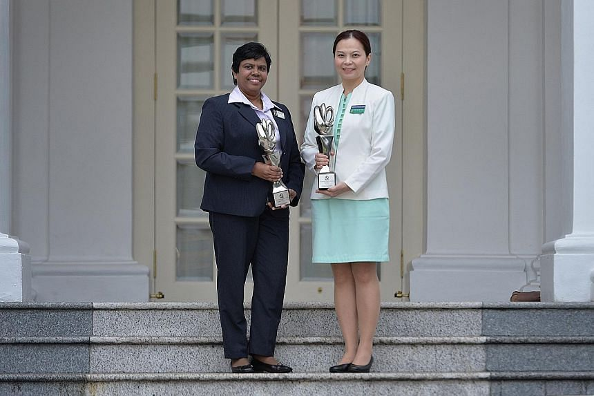 Ms Velusamy Poomkothammal (left), Khoo Teck Puat Hospital's assistant director of nursing, and Dr Lim Su-Fee, a senior nurse clinician at Singapore General Hospital, were among those who received their awards yesterday from President Tony Tan Keng Ya