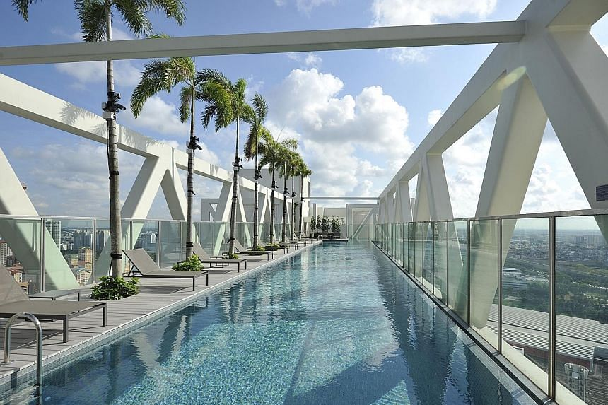 The 38th floor of Sky Habitat has a pool (left) that offers a panoramic view of central Singapore.