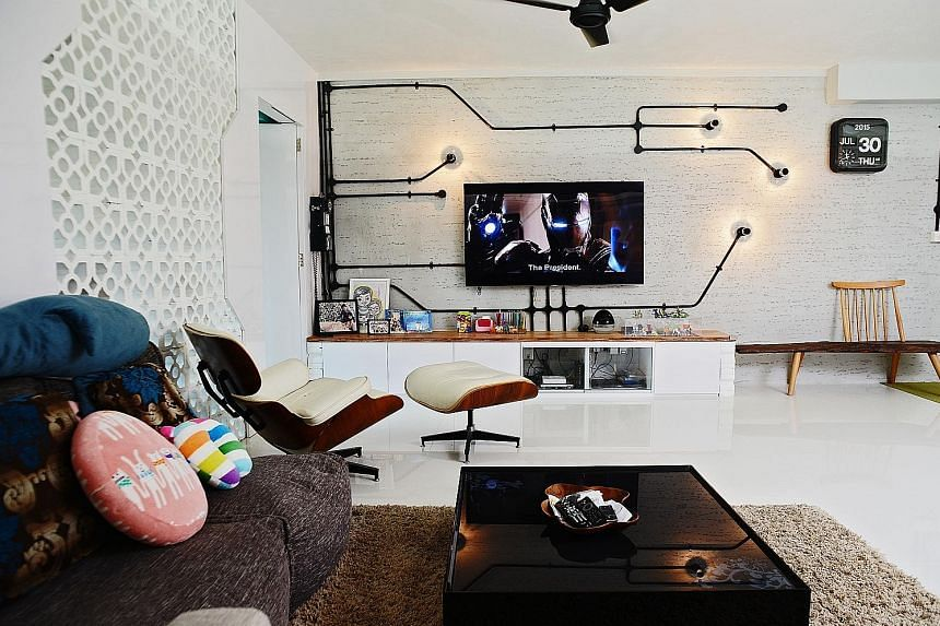 A custom- designed wall with lightbulbs (right) forms the backdrop for the flatscreen television set in the living room. The built-in white wardrobe (above) in the master bedroom. An opening in the wall of the master bathroom (right) allows the user