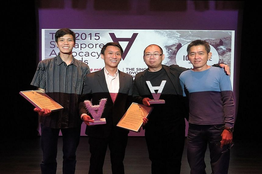 Civil society advocate of the year Remy Choo Zheng Xi (second from left) with civil society advocate organisation of the year The Online Citizen's editors (from left) Howard Lee, Terry Xu and Andrew Loh attending the awards event yesterday.