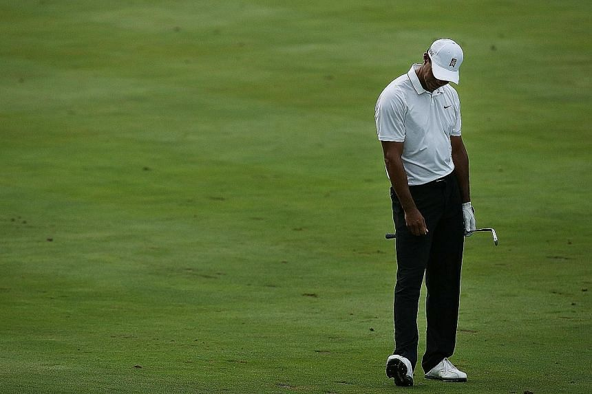 Tiger Woods, who engineered a turnaround on the back nine at the Quicken Loans National, says he is still working with swing coach Chris Como.