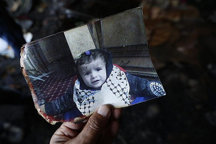 A photograph of 18-month-old Ali Dawabsha who was killed when his home was set alight in the West Bank village of Duma yesterday. Several others were also injured in the attack.