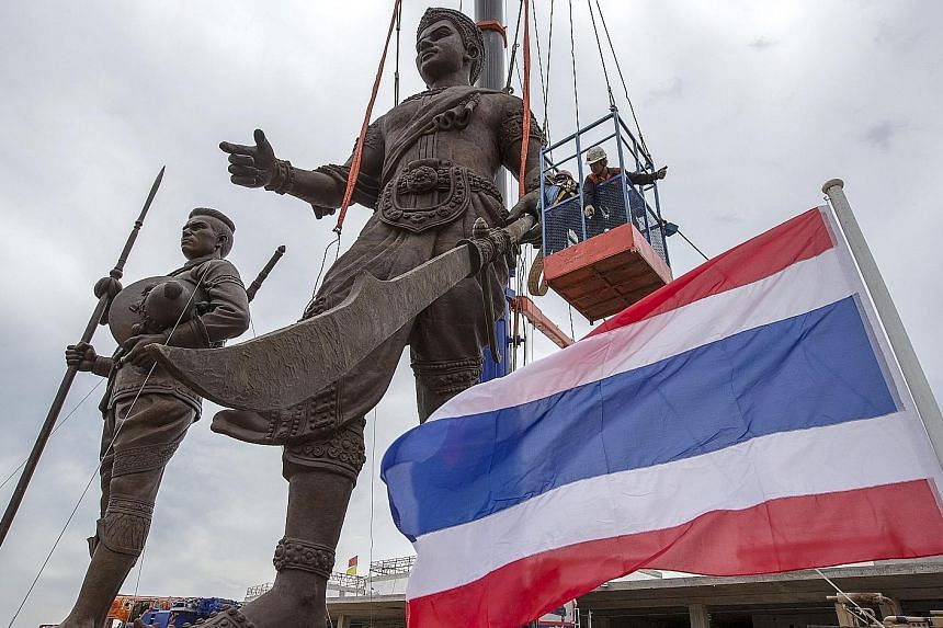 The move to display a collection of giant statues of past kings, such as Ramkhamhaeng (right) and Naresuan (left) at one spot is seen by some as an attempt to consolidate royalist ideology.