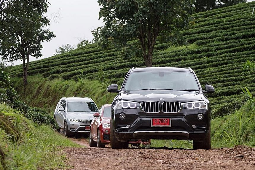 The convoy of BMW X models that the marque calls Sport Activity Vehicles rolling through the mountain roads of Chiang Rai.