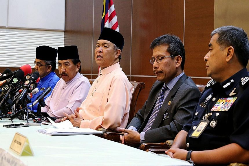 Datuk Seri Ahmad Zahid Hamidi (third from left) at his first press conference as Deputy Prime Minister yesterday, along with police chief Khalid Abu Bakar (right) and officials from the Sabah government and Home Ministry. Mr Zahid said there was no a