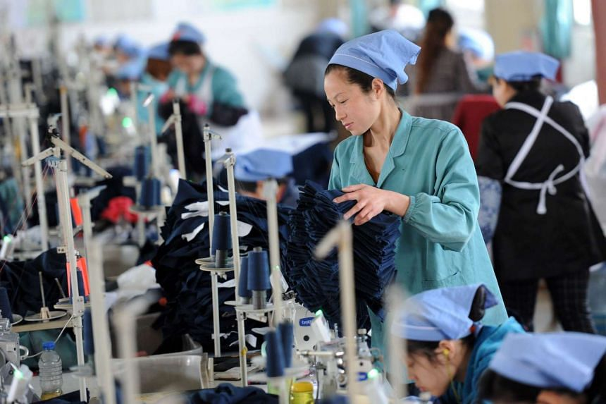 Workers at a garment factory in Huaibei, east China's Anhui province.