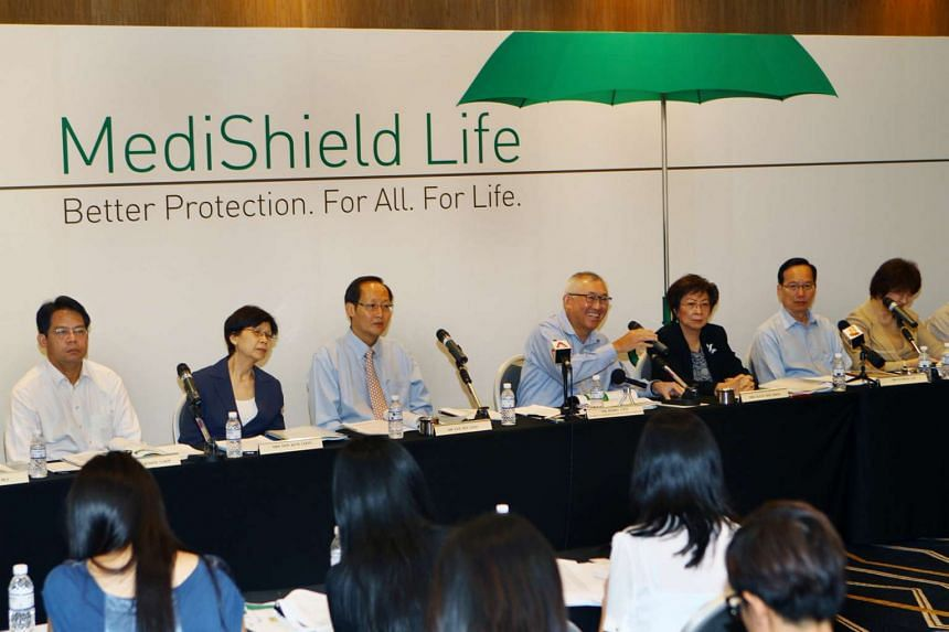 Chairman Mr Bobby Chin (fourth from left) with members of the Medishield Life Review Committee, speaking during the press conference, held at the Suntec City Convention Centre on June 27, 2014.
