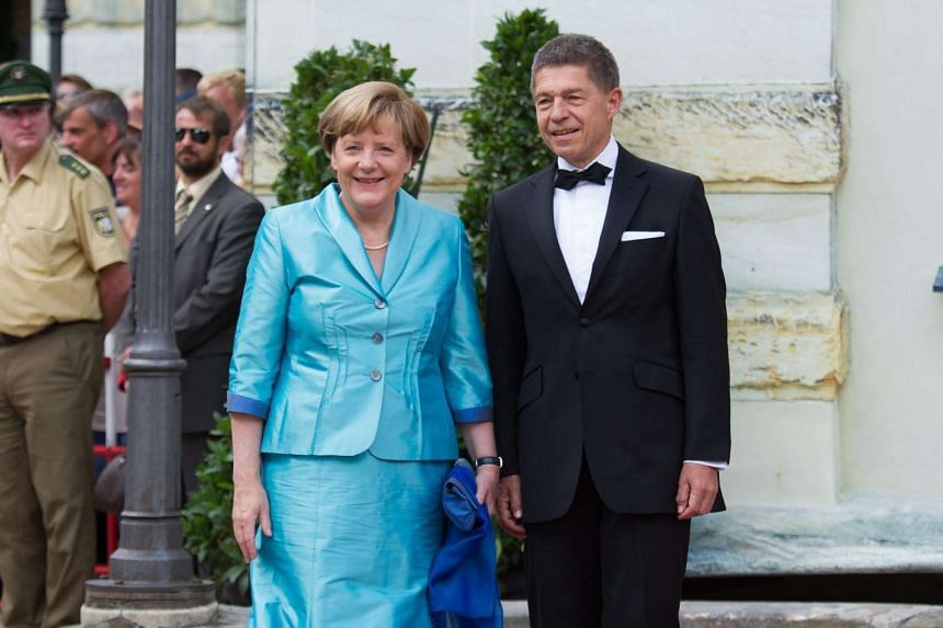Merkel (left) and husband Joachim Sauer arrive for the opening of the Bayreuth film festival in Germany on July 25, 2015.