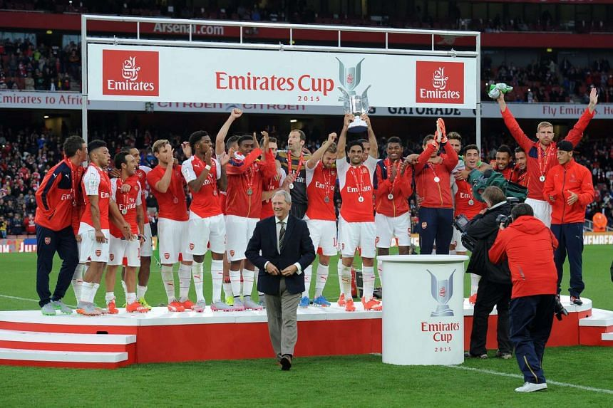 Arsenal lifting the Emirates cup after beating VFL Wolfsburg in London, Britain on July 26, 2015.