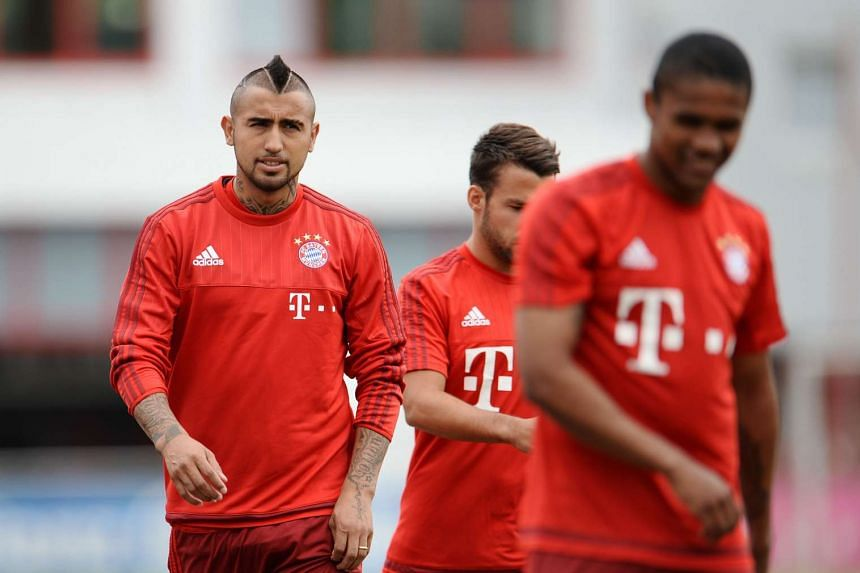 Baryern Munich new recruit Arturo Vidal (left) takes part in a training session on July 29, 2015.