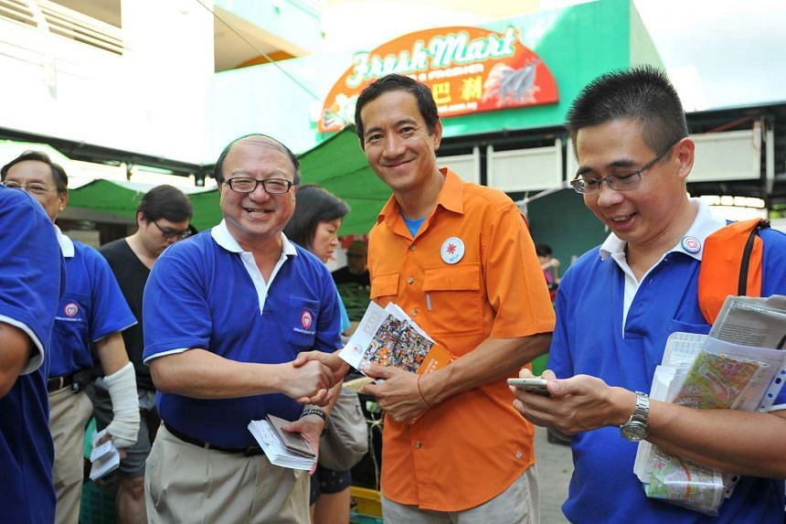 Dr Ang Yong Guan (left) from SingFirst shaking hands with Mr Steve Chia from NSP during their walkabouts in Tampines on July 26, 2015.