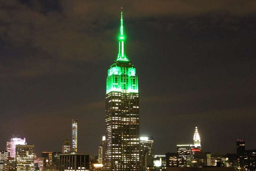The Empire State Building lit in green in New York City to mark the end of Ramadan. A looping reel showing different creatures will be projected on it.