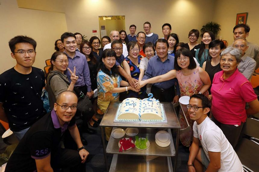 Readers celebrating The Big Read Meet's second anniversary on July 29. Cutting the cake are (from left) Madam Tina Wah, Mr George Tan, Straits Times senior writer Cheong Suk-Wai, Ms Ong Min Yee, Mr Richard Sng and Ms Lee Mei Chuen.