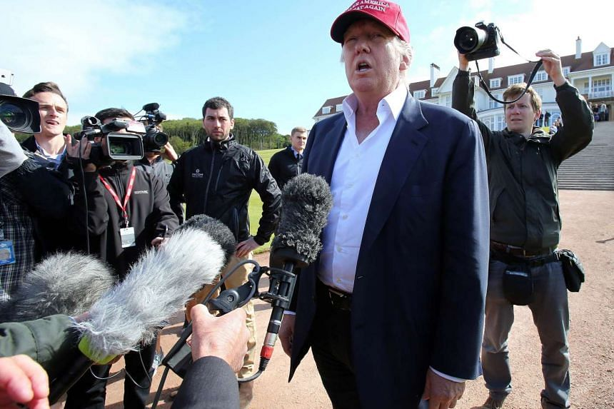 US billionaire Donald Trump speaks to the media as he arrives at the Women's British Open Golf Championships in Turnberry, Scotland.