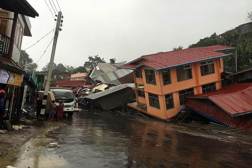Homes destroyed by a landslide caused by heavy rain in Harkhar in Myanmar's Chin state.