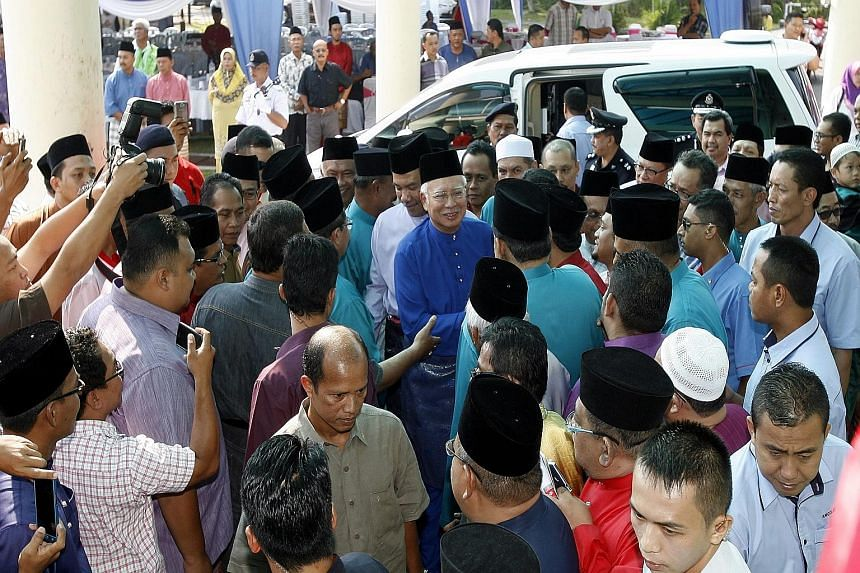 """Umno president Najib Razak arriving to open the Seremban division's annual general assembly. In a speech at the meeting, Mr Najib warned he valued loyalty over intelligence and stated that a """"ship can only have one captain""""."""