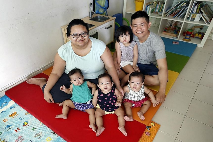 Madam Ermita Soenarto and her husband, Mr Loo Ming Da, with their 10-month-old triplets (from left) Lucia, Liora and Lysbeth, and three-year-old daughter Livia.