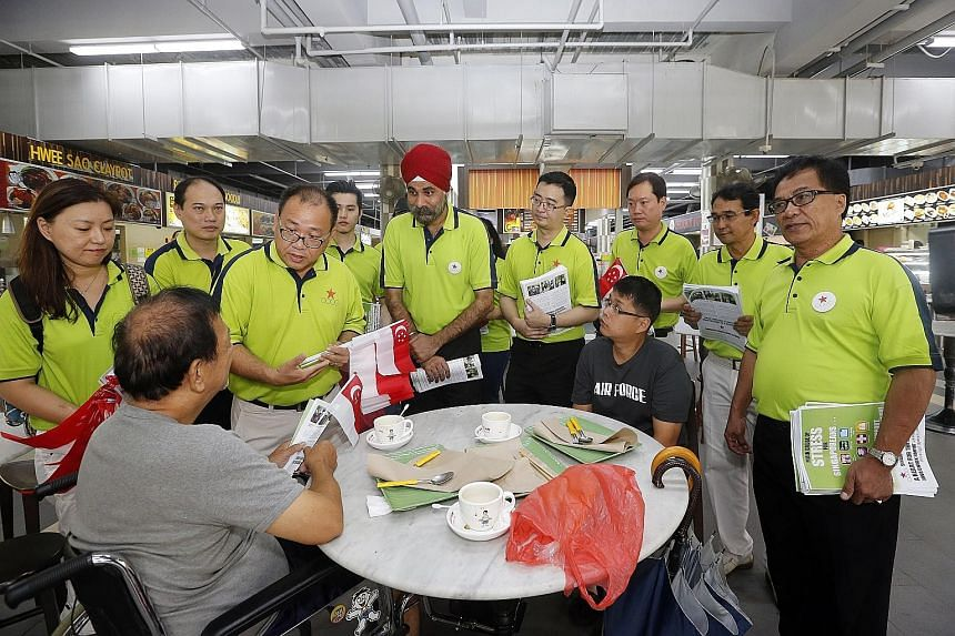 The Singapore Democratic Alliance distributed party leaflets and Singapore flags during a walkabout at Sengkang Square yesterday. The party is returning to contest six-MP Pasir Ris-Punggol GRC.