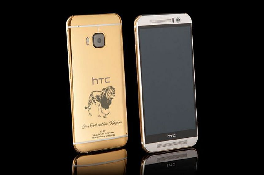 The gold-plated HTC One M9 smartphone with a laser engraving of Cecil the lion.