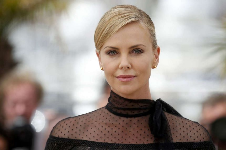 Theron poses during a photocall for the film Mad Max: Fury Road.