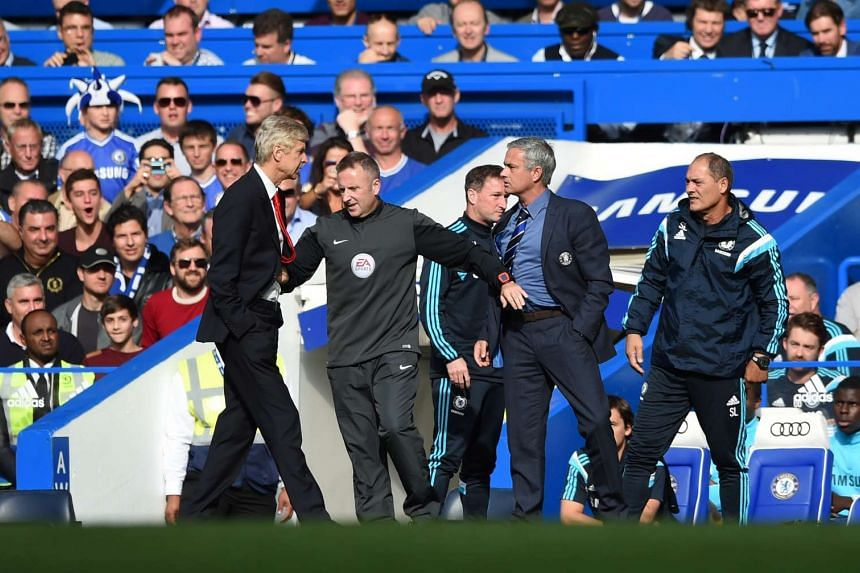 Chelsea Manager Jose Mourinho and Arsenal Manager Arsene Wenger clash during the Barclays Premier League match between Arsenal and Chelsea.