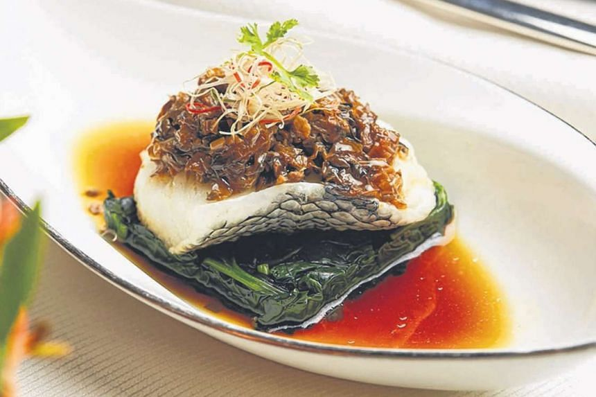 Steamed Chilean Sea Bass With Crispy Fermented Bean Crumbs And Vegetables (above) at Cassia.