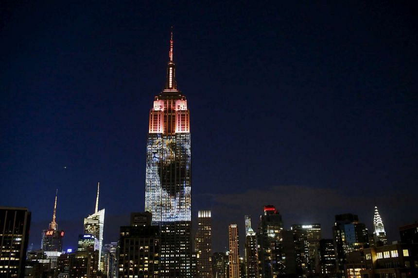 An image of Cecil the lion is projected onto the Empire State Building as part of an endangered species projection to raise awareness, in New York on Aug 1, 2015.