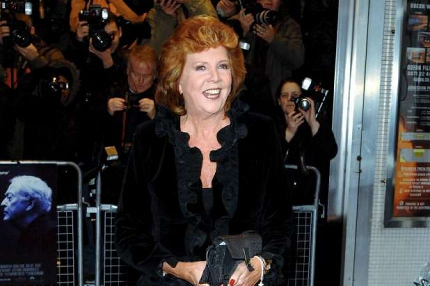 """British presenter Cilla Black poses at the premiere of """"Sleuth"""" in London on Nov 18, 2007."""