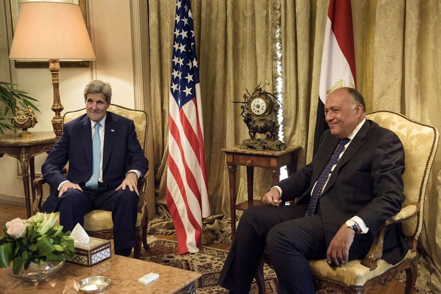 US Secretary of State John Kerry (left) speaks with Egyptian Foreign Minister Sameh Shoukry before a meeting at the Ministry of Foreign Affairs in Cairo on Aug 2, 2015.