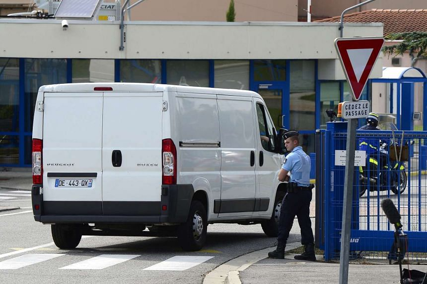 A van carrying a piece of airplane wreckage that washed ashore on Saint-Andre Reunion, arrives at the Directorate General of Armaments (DGA) Aeronautical Technical Centre in Balma, near Toulouse, France, on Aug 1, 2015.