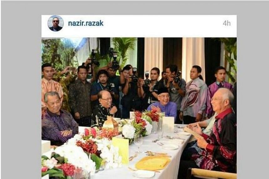 """A picture posted by Malaysian banker Nazir Razak showing Malaysian Prime Minister Najib Razak's (right) """"last supper"""" with former deputy prime minister Muhyiddin Yassin (left)."""